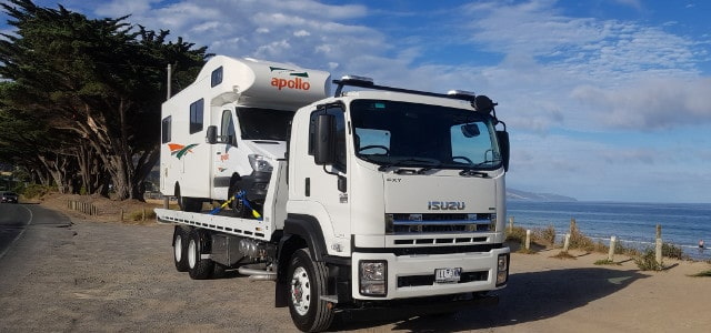 Tow truck towing motorhome