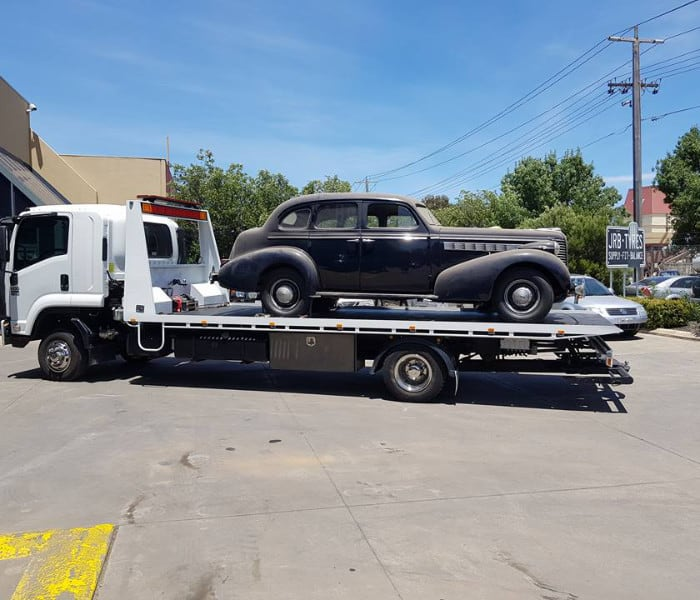 Tow truck towing a classic car
